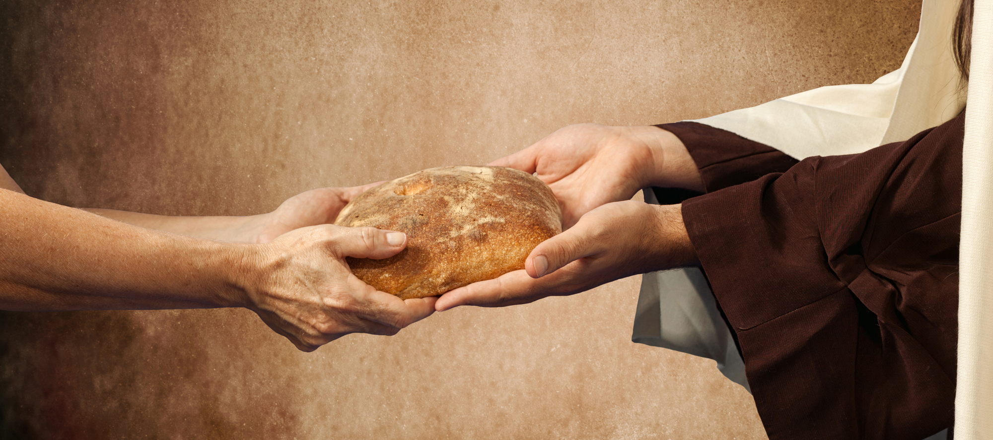 Jesus gives the bread to a beggar.